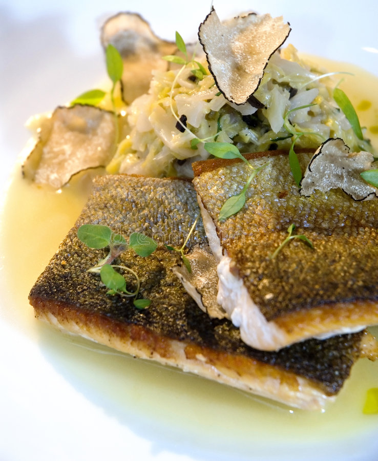 Seabass and truffels. Baked seabass and truffel slaw royalty free stock photo