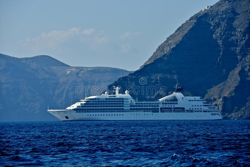 Seabourn Odissey cruise ship anchored in front of Santorini stock photography