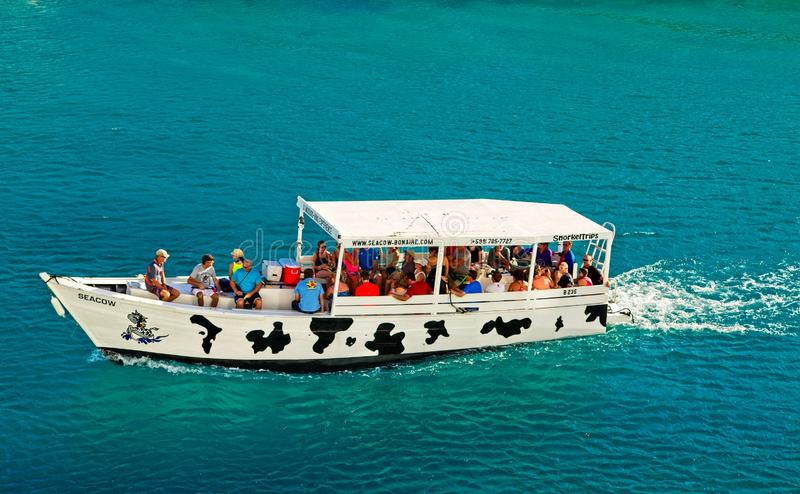 Seacow Bonaire Boat. The Seacow Bonaire tour boat sailing in the harbor royalty free stock photo