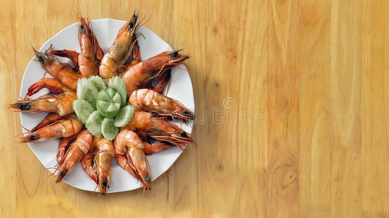 Seafood background of baked shrimp in pepper sauce serve with thai style spicy chili sauce on wooden table royalty free stock image