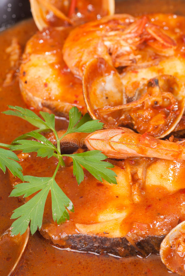 Seafood in cider sauce. Merluza a la Sidra, a Spanish cuisine classic royalty free stock photography