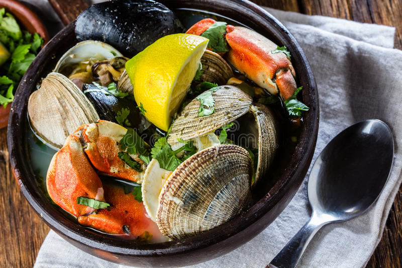 Seafood clams crabs mussela soup. Mariscal royalty free stock images