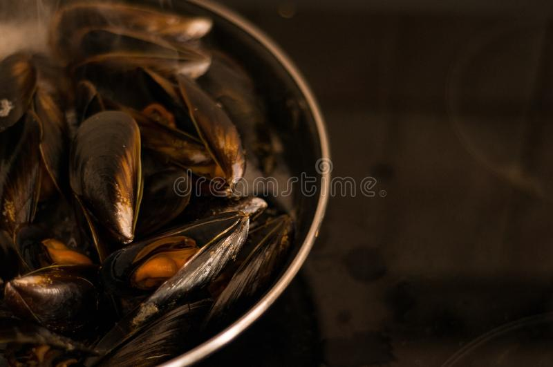 Seafood. Cooking mussels. Mollusks. Healthy food. Cooking at home. Restaurant stock photos