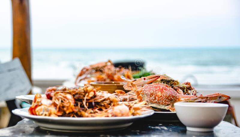 Seafood crab of restaurant with other dishes in the background stock photography