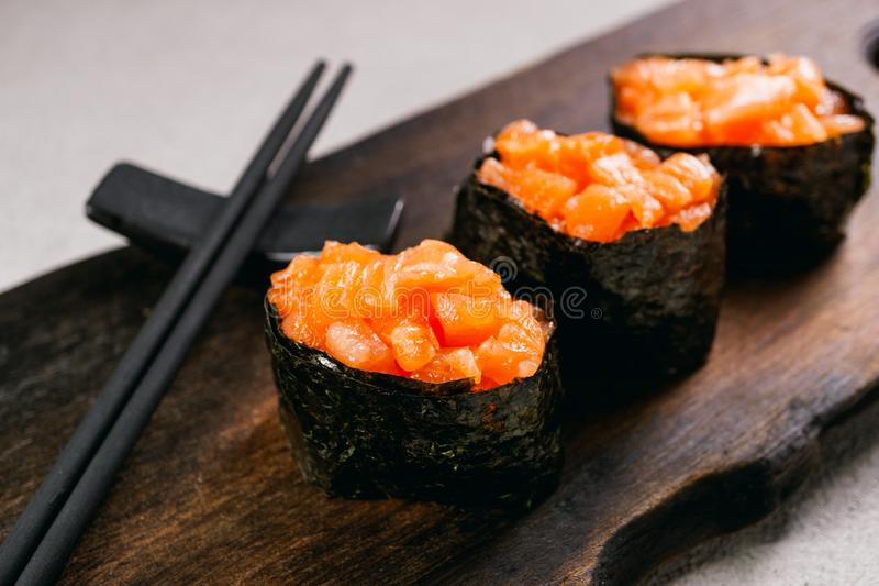 Seafood delicatessen salmon gunkan maki sushi roll royalty free stock images