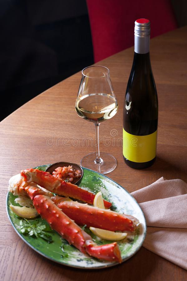 Seafood dinner with white wine royalty free stock photo