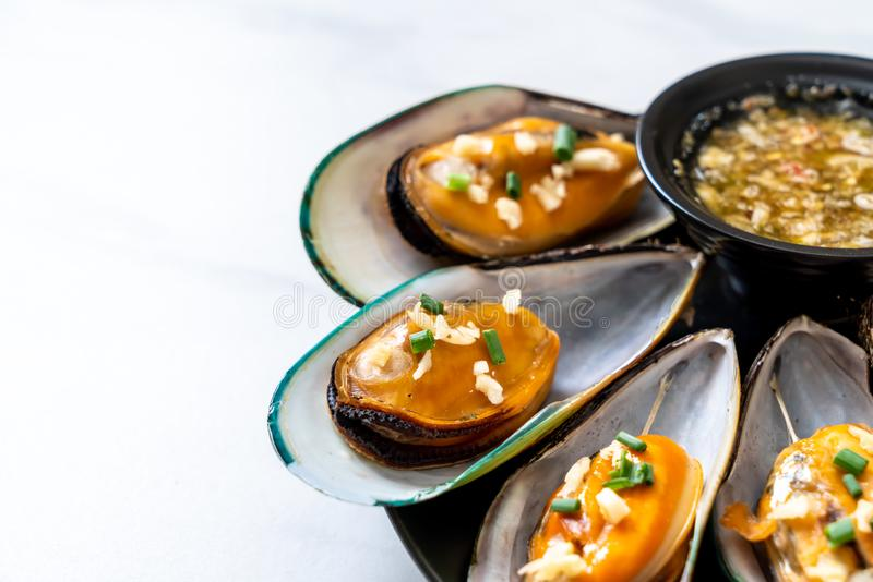 Mussels with lemon and garlic. Seafood mussels with lemon and garlic royalty free stock images
