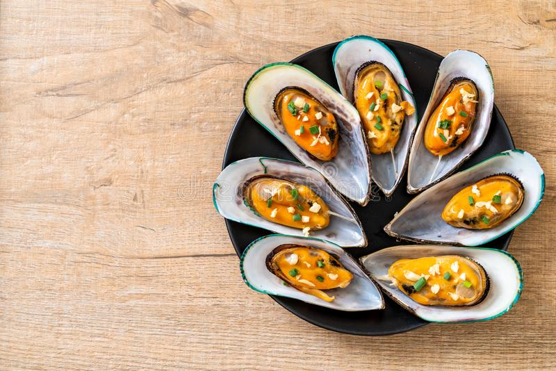 Mussels with lemon and garlic. Seafood mussels with lemon and garlic stock image