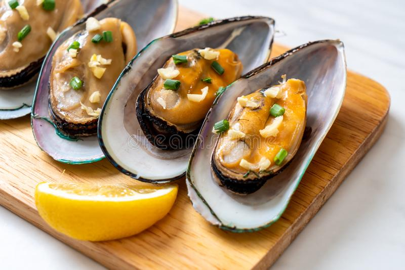 mussels with lemon and garlic stock photo