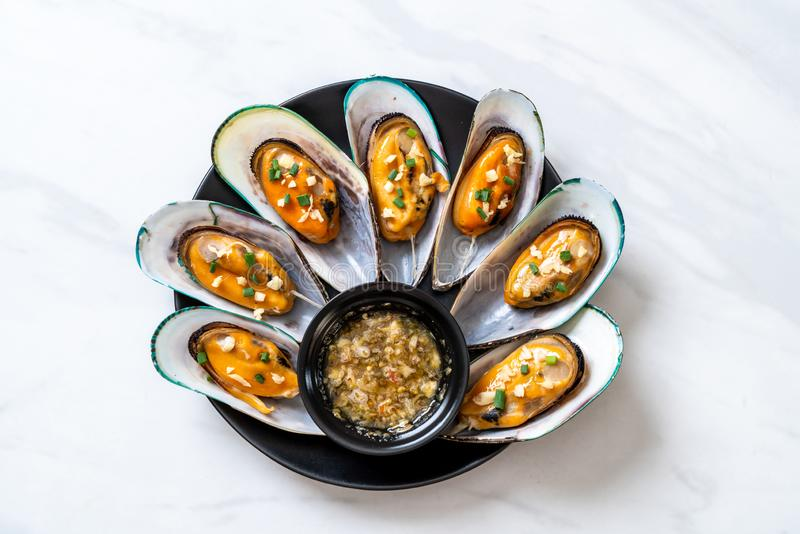 Mussels with lemon and garlic. Seafood mussels with lemon and garlic stock photo