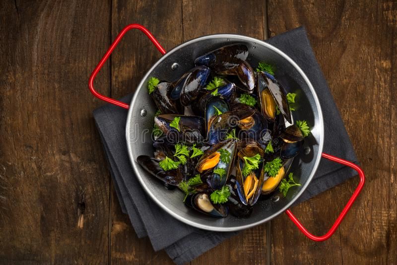 Seafood Mussels in Pan, Top View on Wooden Background, Copy Space royalty free stock image