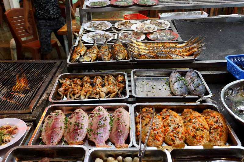 Seafood in night market in Phu Quoc Island, in Vietnam. Traditional asian night market with delicious seafood and exotic food for tourist. Marinated fish and stock image