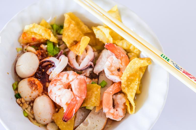 Seafood noodle Tom Yum in white bowl on white background, Thai food, Street food. stock images