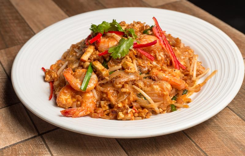 Seafood pad Thai dish of stir fried rice noodles.Thailand`s national dishes. Seafood pad Thai dish of stir fried rice noodles on white dish.Thailand`s national royalty free stock image