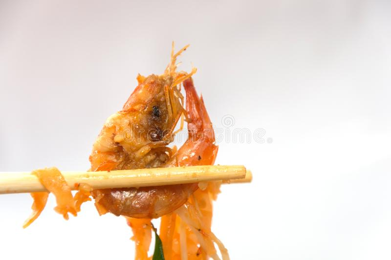 Seafood pad thai on plate. With chopsticks royalty free stock photography