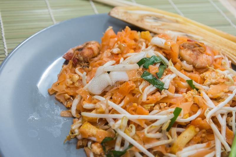 Seafood pad thai on plate. With chopsticks royalty free stock photo