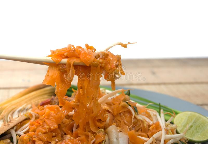 Seafood pad thai on plate. With chopsticks royalty free stock images