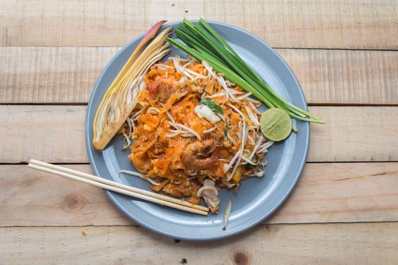 Seafood pad thai on plate. With chopsticks stock photos