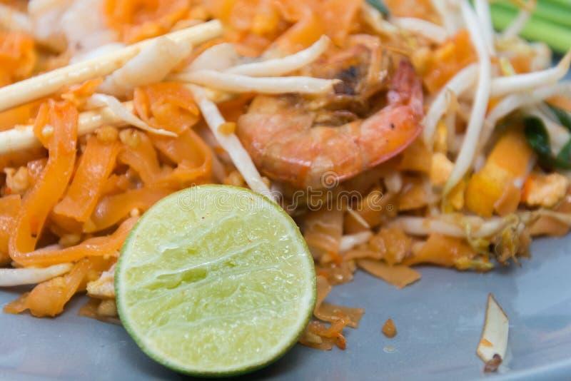 Seafood pad thai on plate. With chopsticks stock image