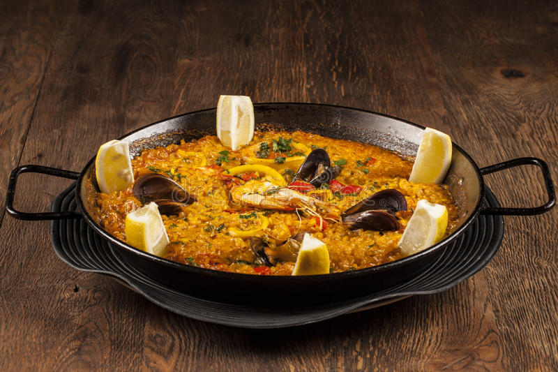 Seafood Paella. Spanish rice specialty, seafood Paella with lemon royalty free stock photo