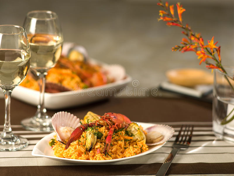 Seafood Paella. Arroz con mariscos, a typical Peruvian dish in elegant, fine dining setting royalty free stock photos