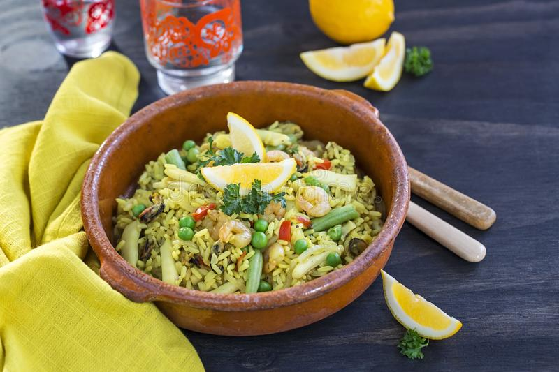 Seafood paella with green beans stock photography