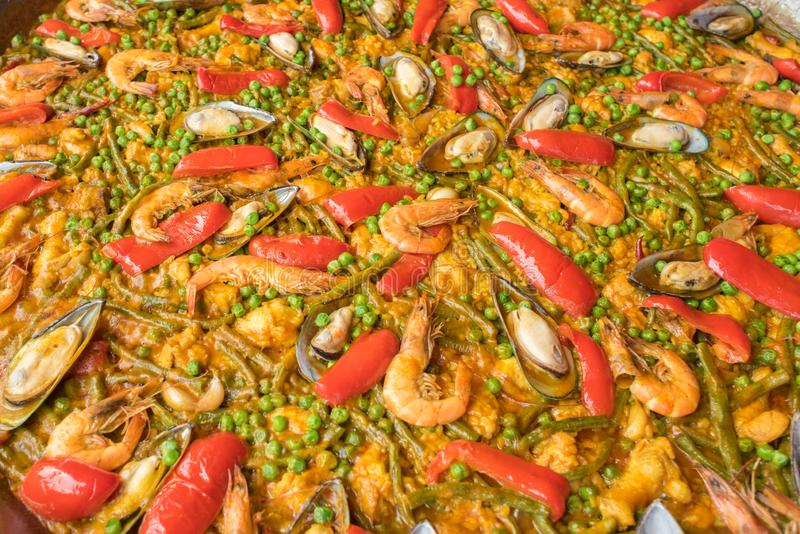 Seafood paella on a large frying pan, close up royalty free stock photos
