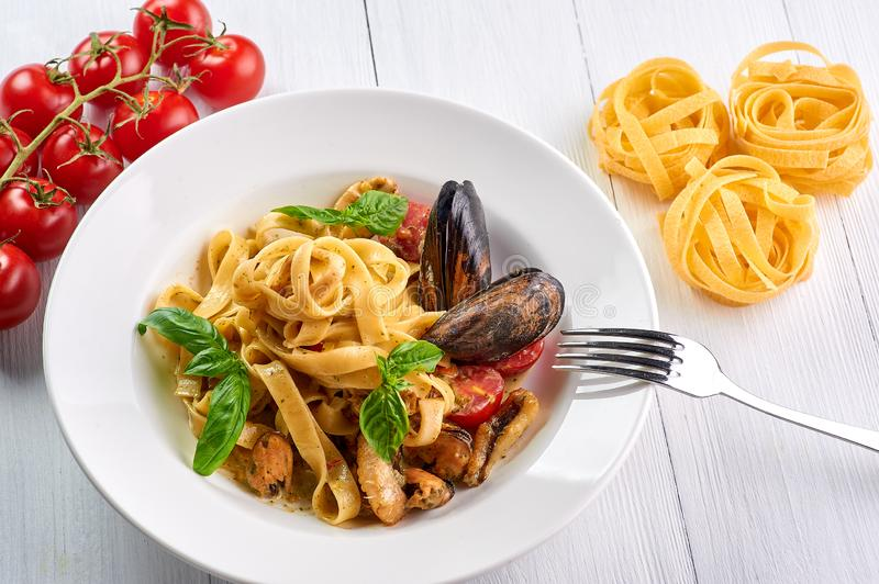 Seafood pasta fettuccine with mussels and basil. Spaghetti vongole - traditonal italian cuisine dish. With pasta and clams stock photos