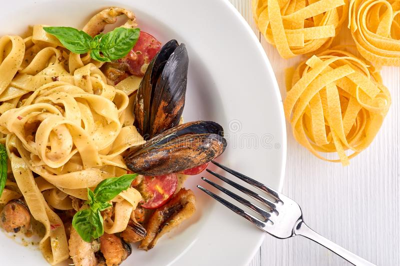 Seafood pasta fettuccine with mussels and basil. Spaghetti vongole - traditonal italian cuisine dish. With pasta and clams stock photography