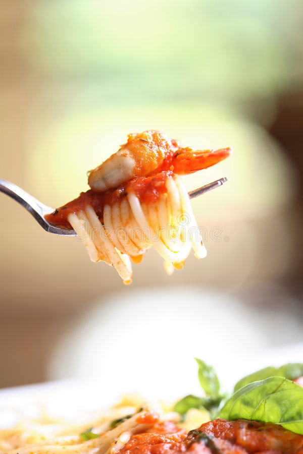 Seafood pasta2. Fork lifting up some pasta and seafood royalty free stock image