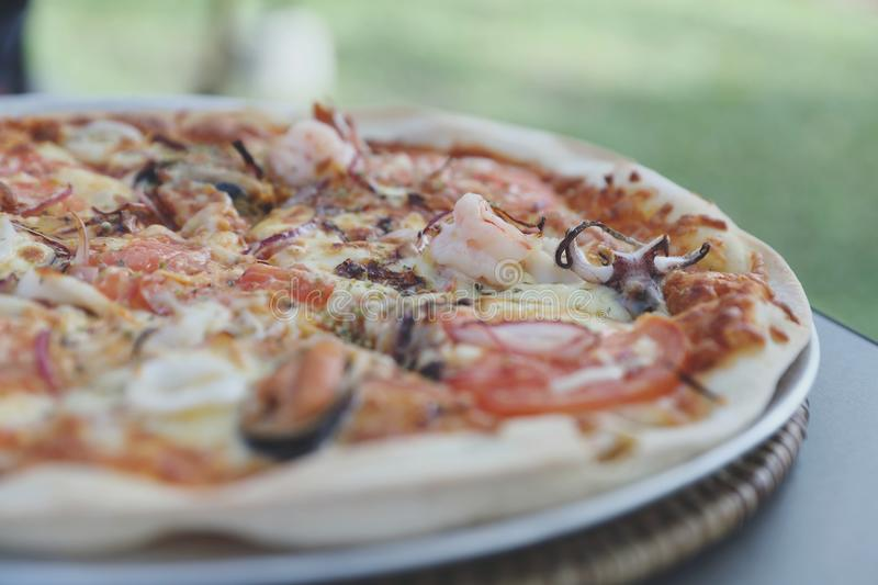 Seafood pizza , with mussel squid shrimp and tomato , italian food royalty free stock photo