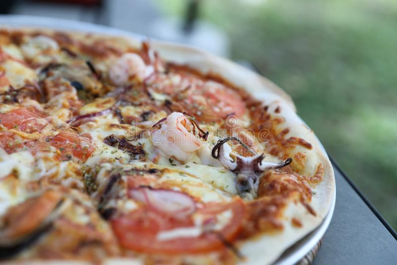 Seafood pizza , with mussel squid shrimp and tomato , italian food stock photos