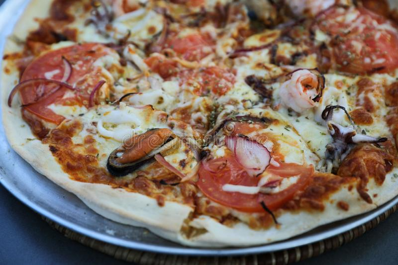 Seafood pizza , with mussel squid shrimp and tomato , italian food. In close up royalty free stock photos
