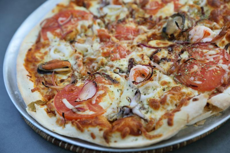 Seafood pizza , with mussel squid shrimp and tomato , italian food. Seafood pizza , with mussel squid shrimp and tomato in close up , italian food royalty free stock photos