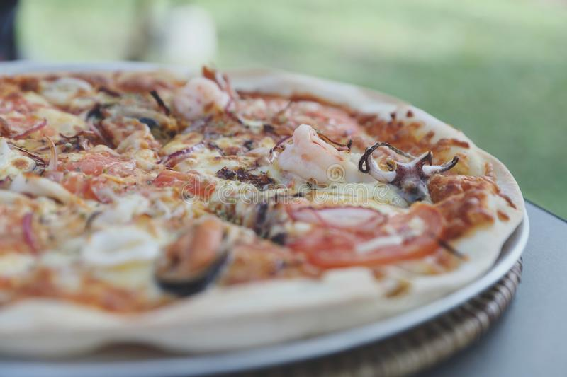 Seafood pizza , with mussel squid shrimp and tomato , italian food. Seafood pizza , with mussel squid shrimp and tomato in close up , italian food stock photos