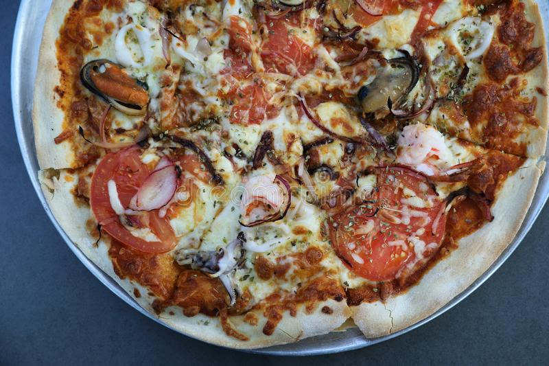 Seafood pizza , with mussel squid shrimp and tomato , italian food. On top view royalty free stock photo
