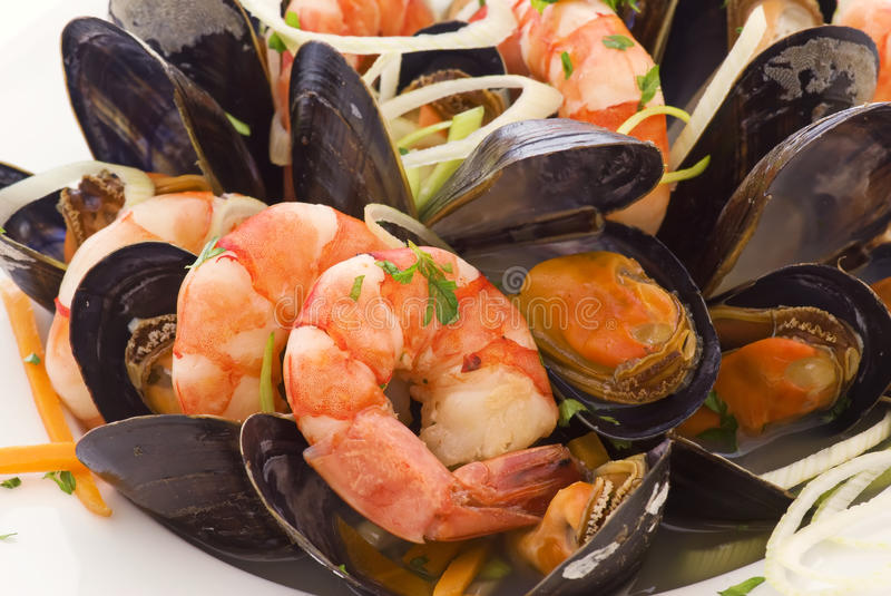 Seafood Platter. With mussels and prawns as closeup on a white plate royalty free stock photo