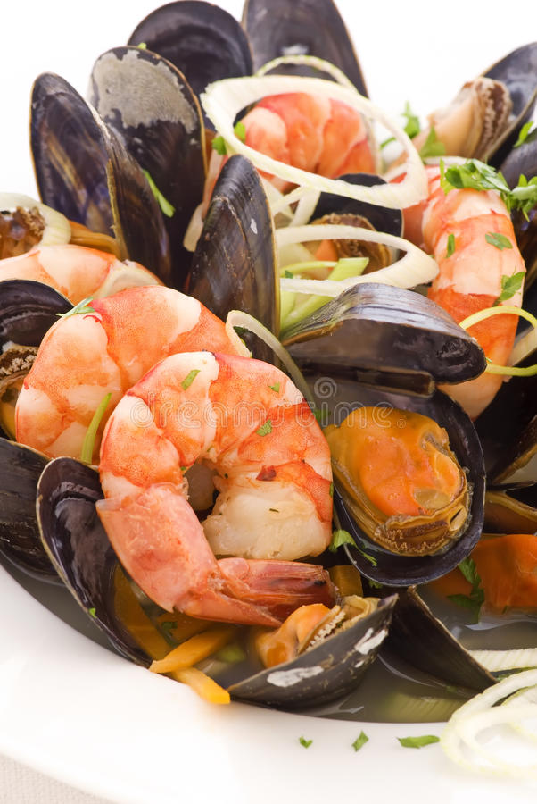 Seafood Platter. With mussels and prawns as closeup on a white plate royalty free stock photography