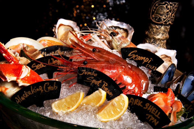 Seafood Platter. Served fresh and deep fried surrounded with ice and different kind of Oyster. Also the Background is some latin decoration royalty free stock photography