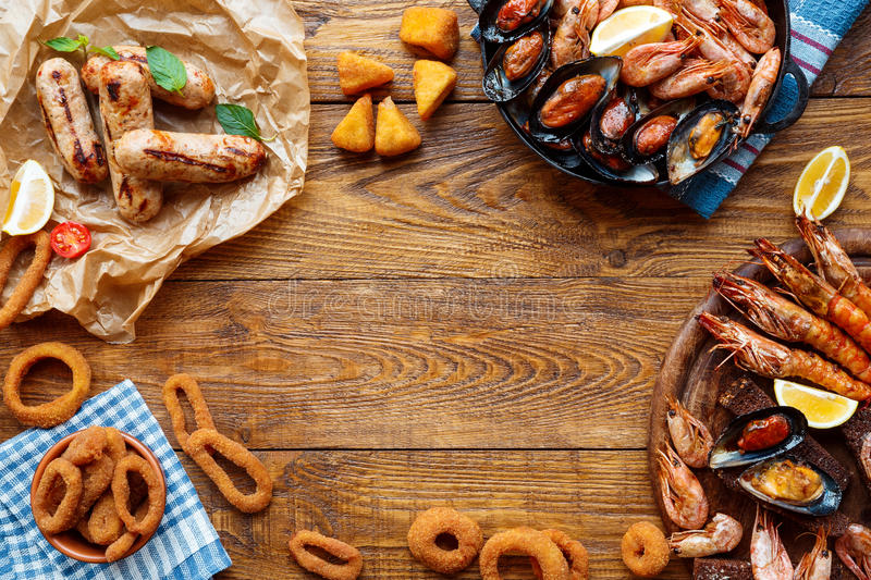 Seafood platter top view, flat lay on wooden table background. Seafood platter and meat on wood, frame background top view, flat lay. Mediterranean cuisine stock images