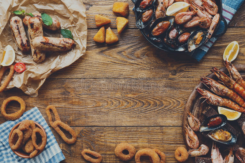 Seafood platter top view, flat lay on wooden table background. Seafood platter and meat on wood, frame background top view, flat lay. Mediterranean cuisine stock image