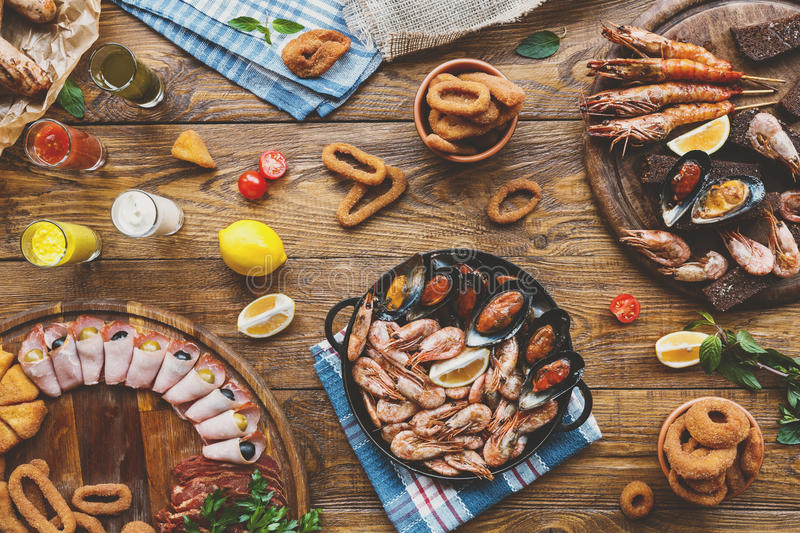 Seafood platter top view, flat lay on wooden table background. Seafood platter top view, flat lay. Mediterranean cuisine restaurant food, fried calamari rings royalty free stock image