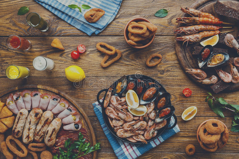 Seafood platter top view, flat lay on wooden table background. Seafood platter top view, flat lay. Mediterranean cuisine restaurant food, fried calamari rings stock images