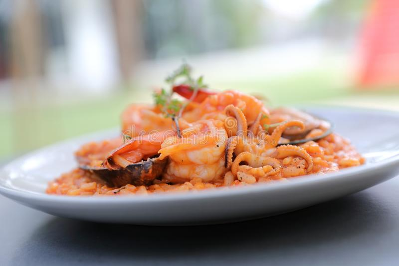 Seafood risotto with mussel shrimp and squid , italian food. Seafood risotto with mussel shrimp and squid on a plate , italian food stock photo