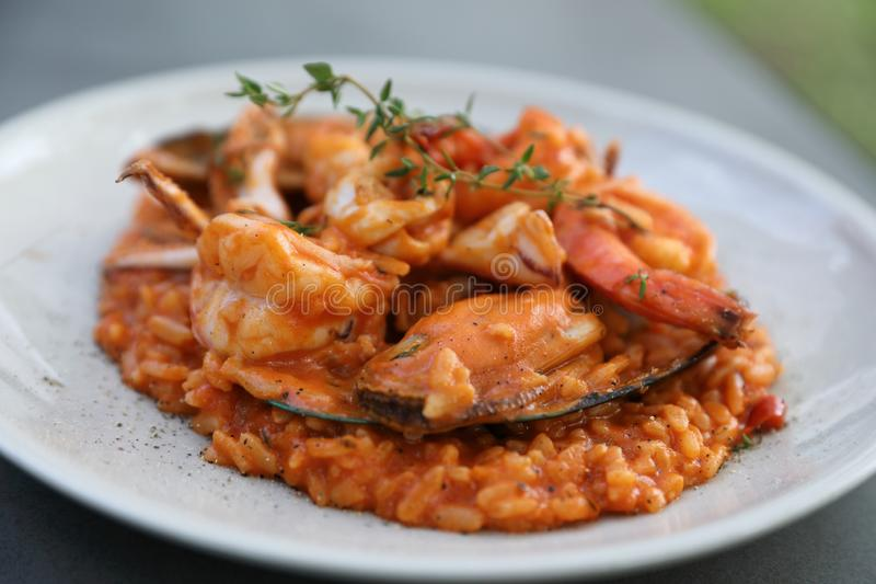 Seafood risotto with mussel shrimp and squid , italian food. Seafood risotto with mussel shrimp and squid on a plate , italian food stock photography