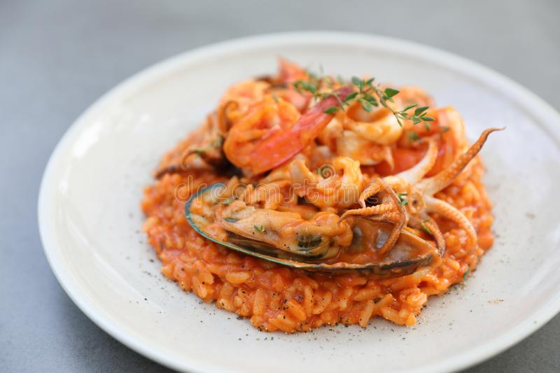 Seafood risotto with mussel shrimp and squid , italian food. Seafood risotto with mussel shrimp and squid on a plate , italian food royalty free stock photography