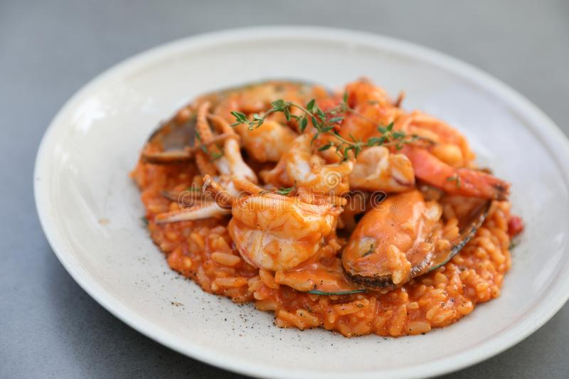 Seafood risotto with mussel shrimp and squid , italian food. Seafood risotto with mussel shrimp and squid on a plate , italian food royalty free stock photos