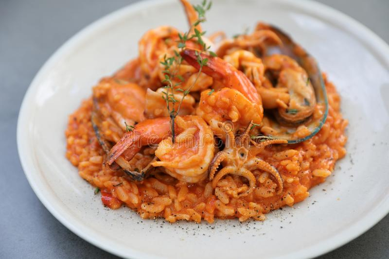 Seafood risotto with mussel shrimp and squid , italian food. Seafood risotto with mussel shrimp and squid on a plate in close up , italian food royalty free stock photo