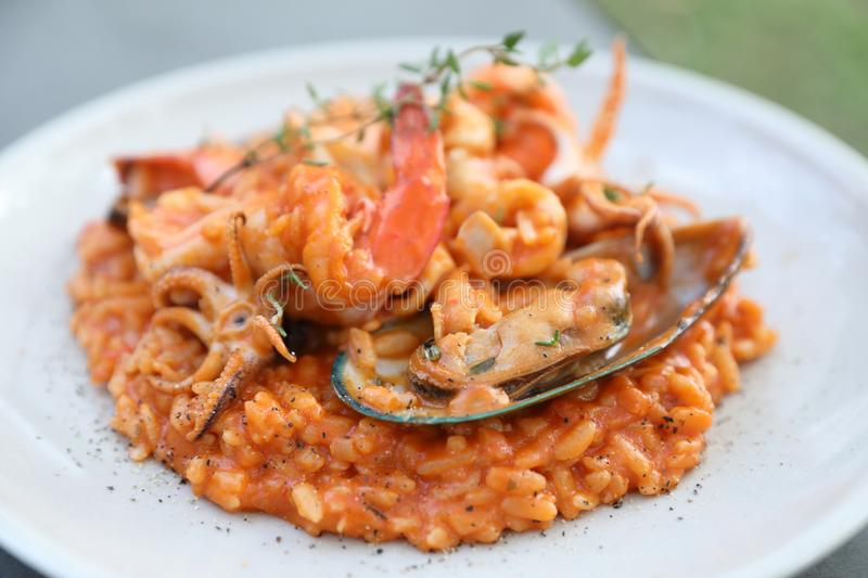 Seafood risotto with mussel shrimp and squid , italian food. Seafood risotto with mussel shrimp and squid on a plate in close up , italian food stock photography