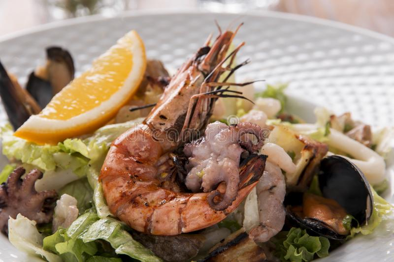 Seafood salad shrimp squid octopus mussel. A stock photos
